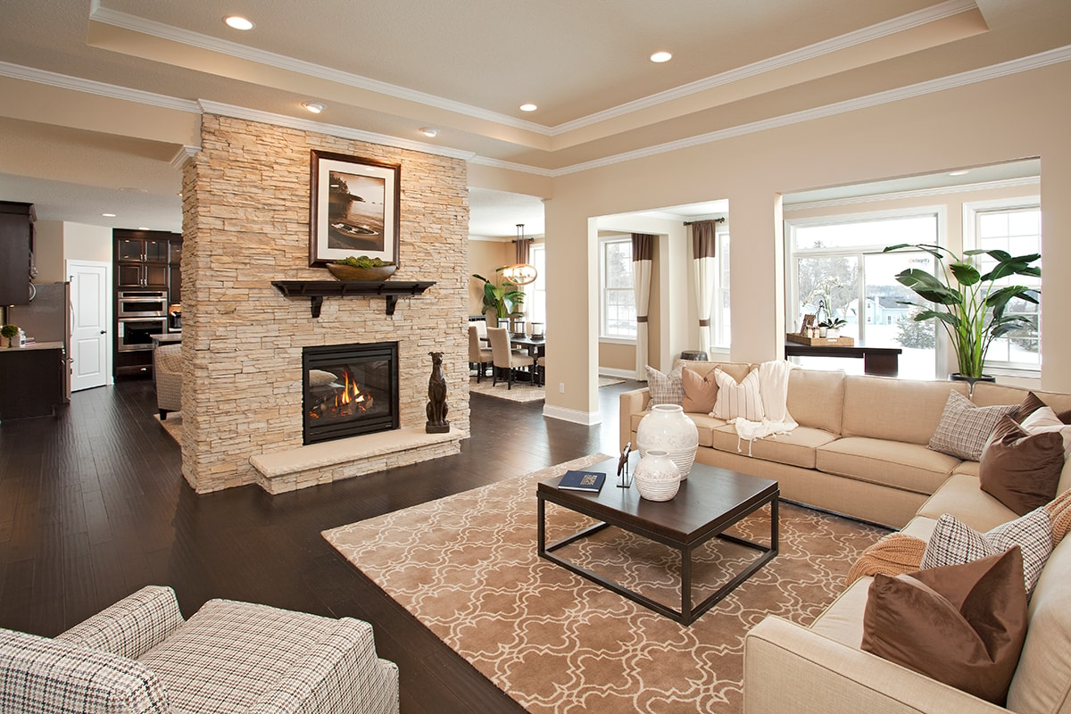 Living room with Heatilator Fireplace with beige stone surround